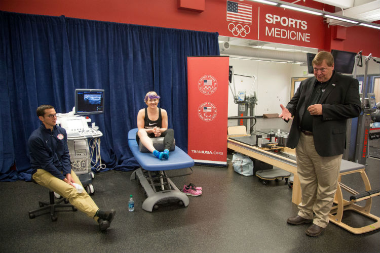 Massage Therapists Working on Olympic Athletes